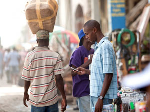 mobile-money-on-street-300x225
